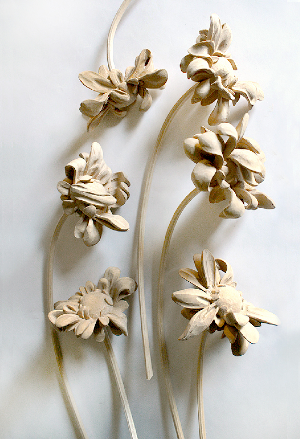 "Wilted Series 1, 2015, Carved Basswood, Approx. 13 X 4"" each"