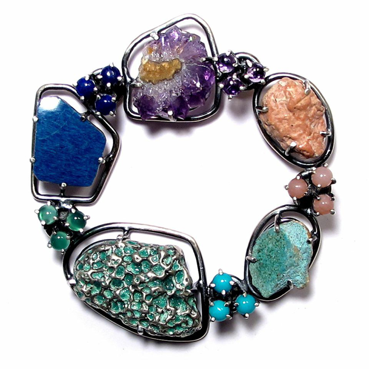 Joanna Gollberg, गम और खोल ब्रोच Gama aura khōla brōca (Brooch), Sterling Silver, Blue Pottery Shard (Western NC), Lapis, Amethyst Crystal, Amethyst, Dried Gum (Mexico), Pink Opal, Concrete (Mexico), Turquoise, Green Enamel (On cast shell from Mexico), Green Onyx